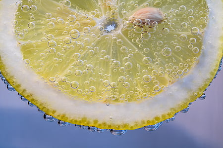 macro photography of sliced lemon in carbonated drink