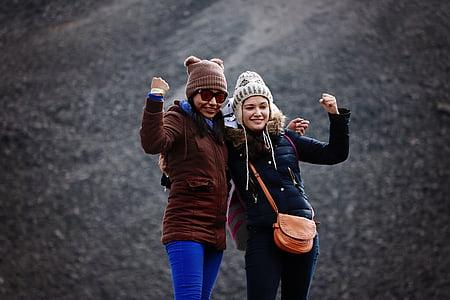 two women wearing jackets beside each other
