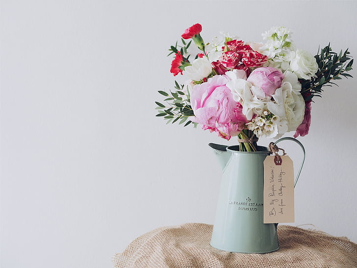 Royalty free photo red pink and white peonies and carnations red pink and white peonies and carnations centerpiece in teal metal watering can mightylinksfo