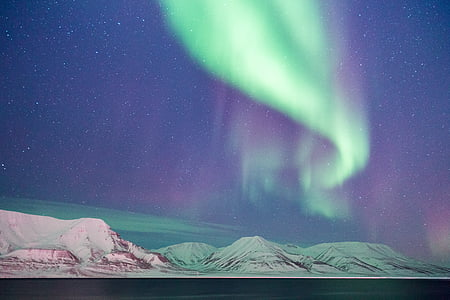 hills under Aurora Borealis lights photo