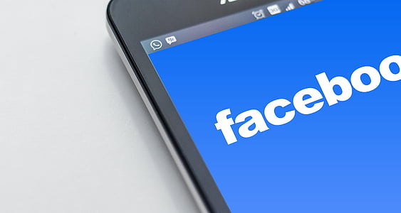 black monitor with Facebook application