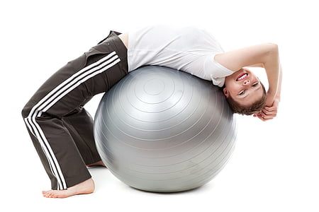 boy on gray stability ball