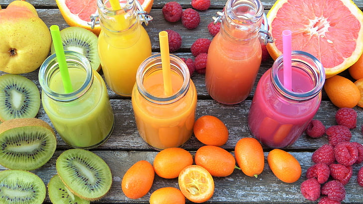 Royalty-Free photo: Five clear glass containers filled with assorted fruit juices | PickPik