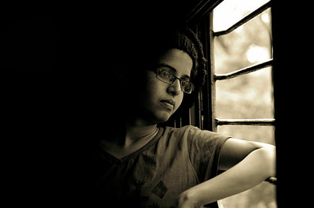woman lean on window