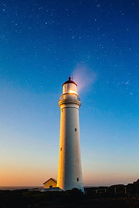 white lighthouse photography during night