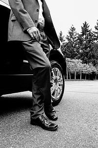 man standing beside car