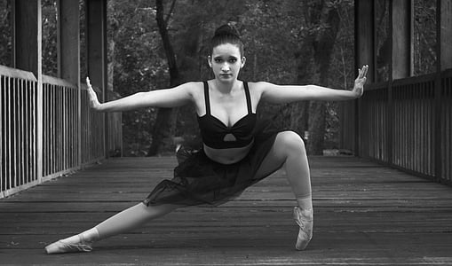 grayscale photo of female ballet dancer in dance post
