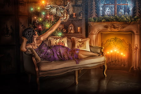 black hair woman in purple dress lying on sofa while holding bird during night time