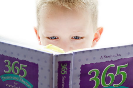 boy holding a 365 story book