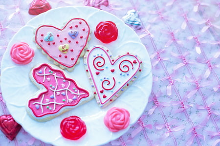 closeup photo of three heart-shaped cookies