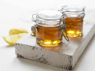 two clear airtight jars with oil