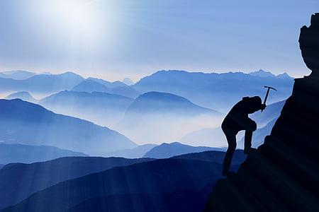 person climbing mountain