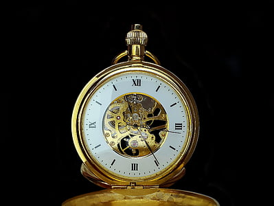 round white and gold-colored pocket watch reading at 11:24