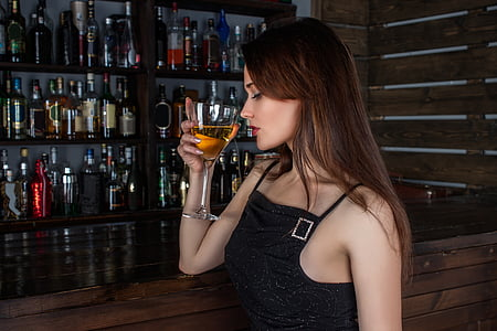 woman drinking wine inside bar