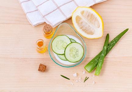cucumber on bowl beside lemon