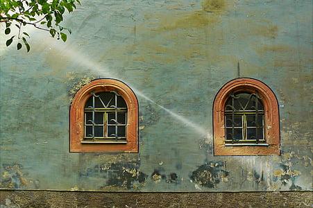 two brown framed arc windowpane