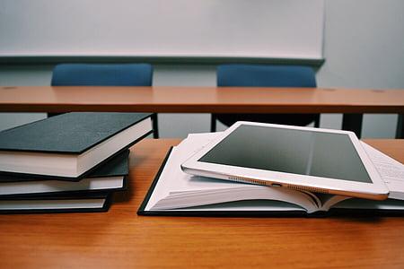 white iPad on book