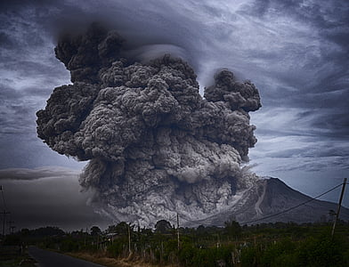 mountain with ash fall smoke
