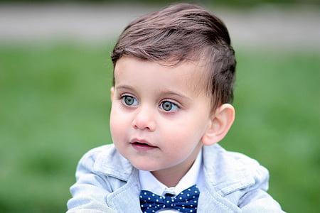 toddler's wearing white tuxedo