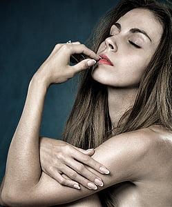 topless woman touching lips