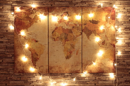 world man 3-panel decor with string lights mounted on brown bricked wall