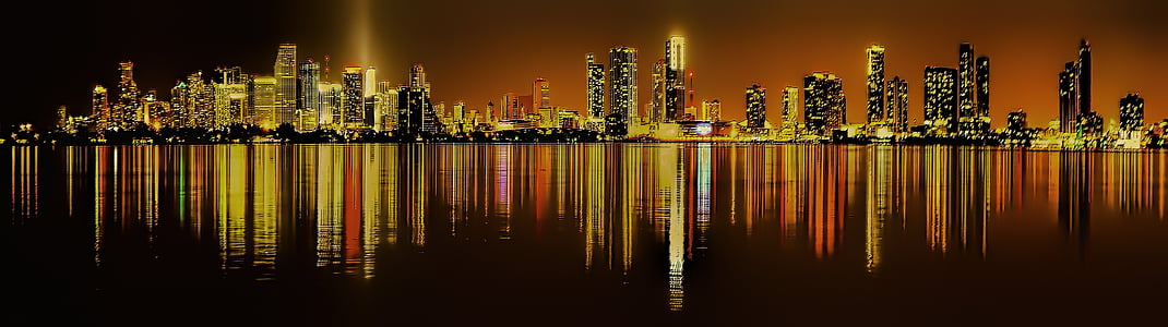 silhouette of high-rise buildings at nighttime