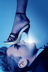 man lying looking on person's stiletto