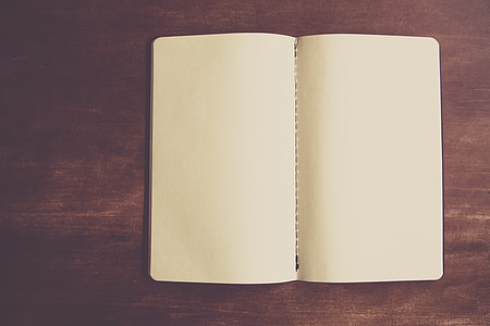 blank notebook on wooden surface