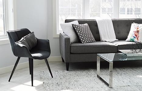 gray pillow on black armchair