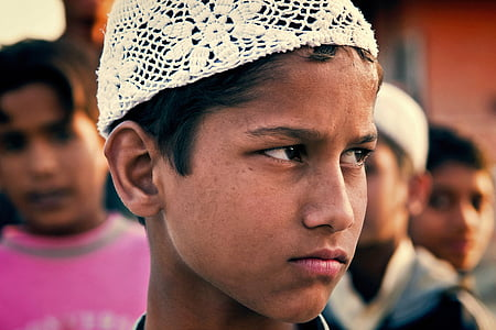 boy with white knitted hat