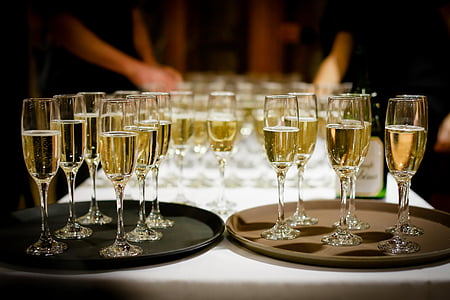 clear champagne glasses with champagne inside