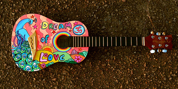 multicolored acoustic guitar