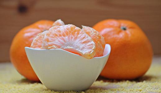 orange fruit on ceramic bowl