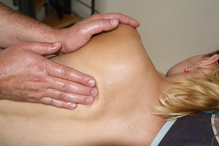 close up photo of person having massage on back