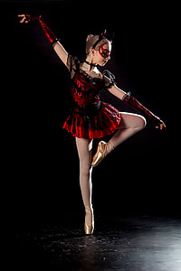 woman wearing red and black ballerina dress