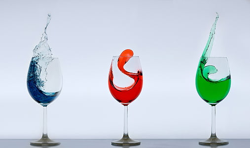 three clear wine glasses with substance