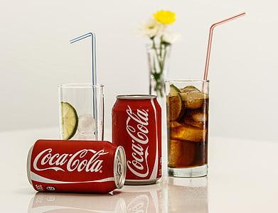 two Coca-Cola soda cans