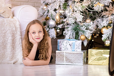 gray, gold, and white Christmas gifts on white ceramic flooring
