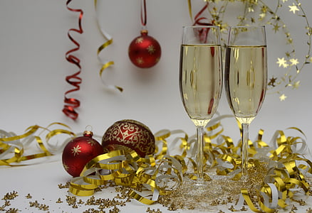 red baubles decor with two champagne glasses