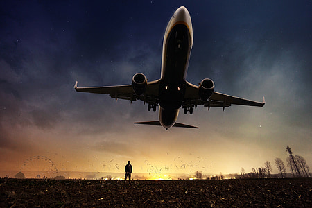 airplane flying above ground digital wallpaper