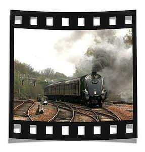 photo of black train against white background