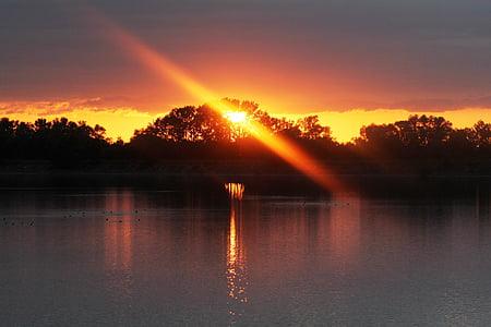 sunset across body of water