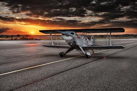 white propeller plane