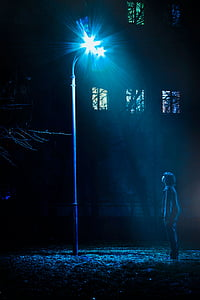 person under the street light