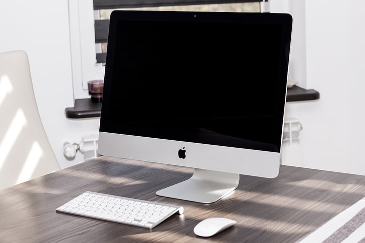 white iMac with Apple keyboard and magic mouse