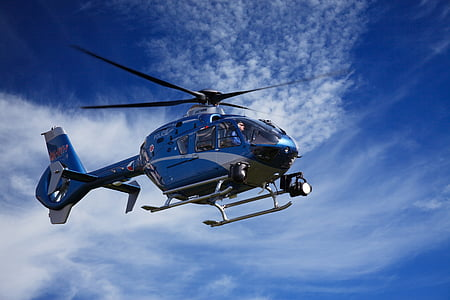 blue and gray helicopter during daytime