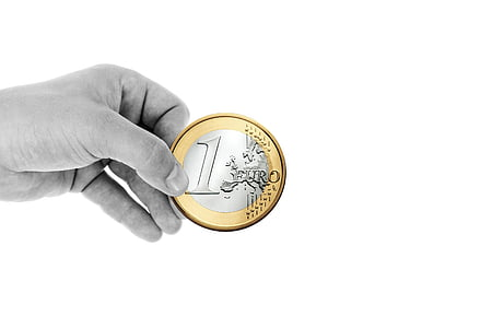 round silver-and-gold-colored 1 Euro coin