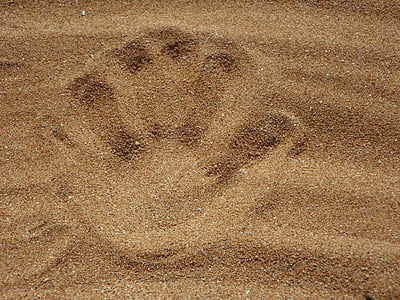 hand print on sand