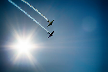 two plane silhouette flying on air