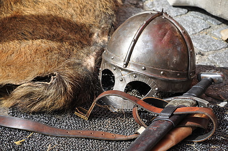 closeup photo of sword and helmet